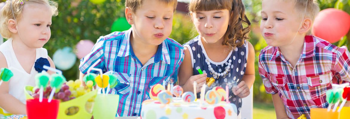bigstock-Kids-Blowing-Candles-On-Cake-A-93954119